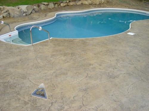 Area piscina con hormigón impreso manta